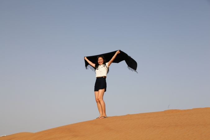 Me on a sand dune in the Arabian desert