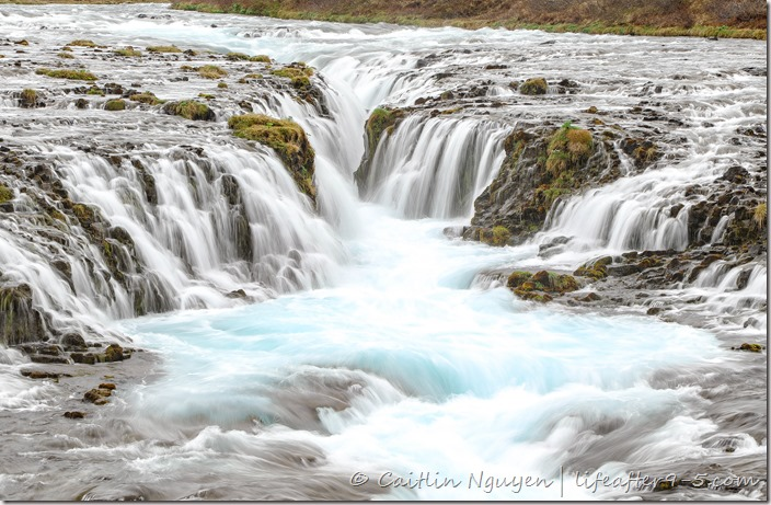 Close up of Bruarfoss and the icy blue water