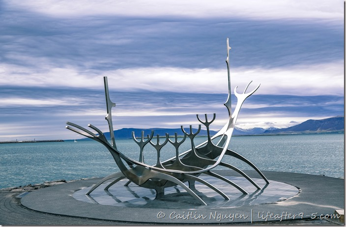 Sun Voyager the famous metallic boat sculpture in Reykjavic against stormy sky