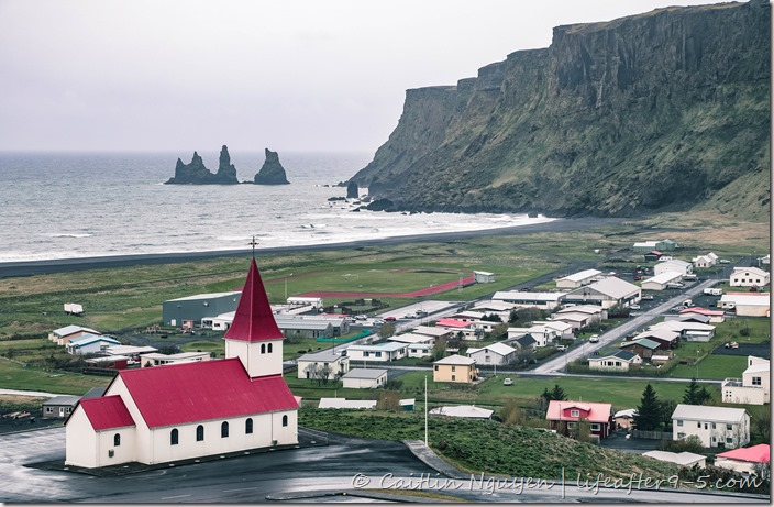 View of the town of Vik from above with church in foreground