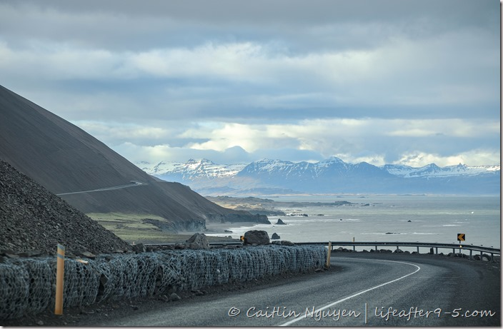 Driving Ring Road in Iceland with scenery of ocean and mountains