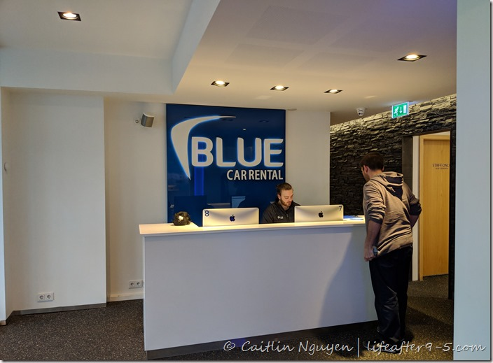 Man waiting to pick up car at Blue Car Rental in Keflavik