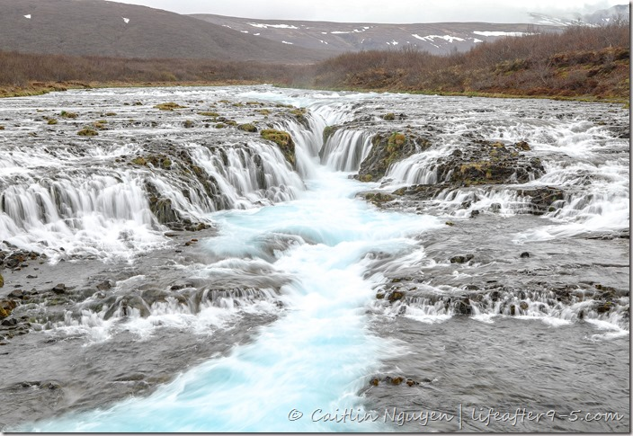 Thousand of icy blue runlets of Bruarfoss