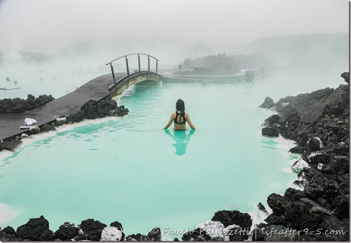Woman bathing in Blue Lagoon
