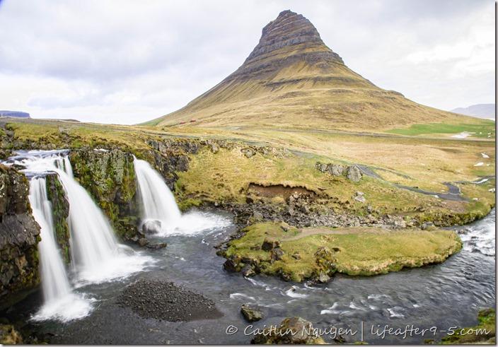 Kirkjufellsfoss with Kirkjufells mountain in the background