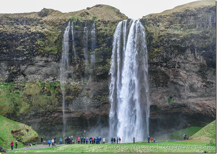 People standing in front of Seljalandsfoss