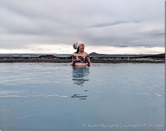 Women in knit hat bathing in Mývatn Nature Baths