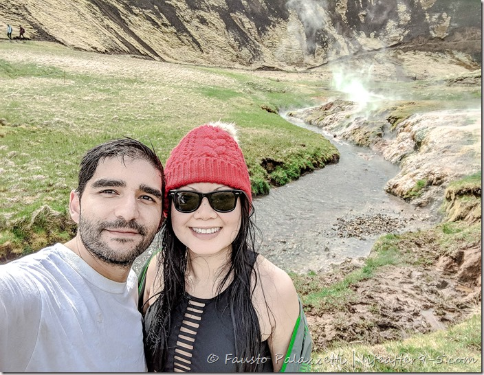 Man and woman bathing in hot spring in Reykjadalur Valley