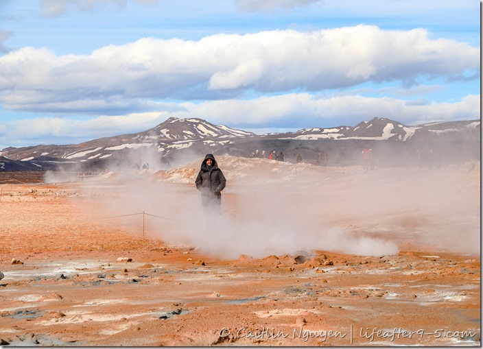 Man standing in the middle of Námafjall Hverir geothermal field