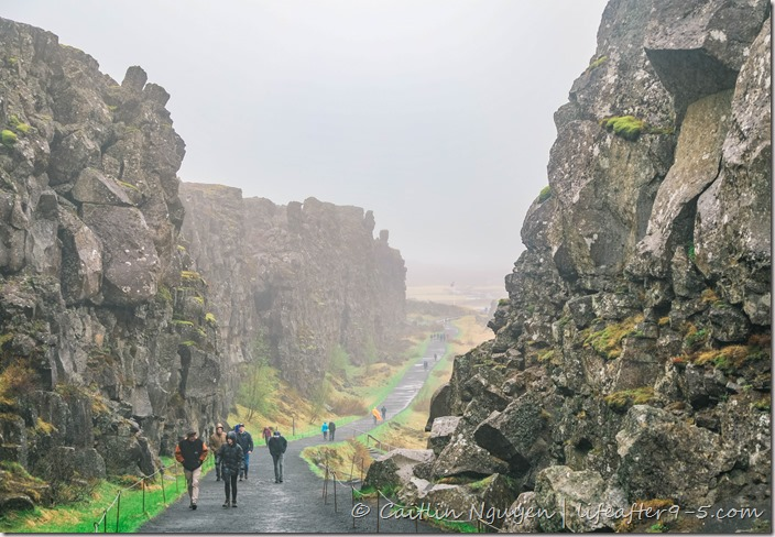 People walking between the rift valley in Thingvellir National Park