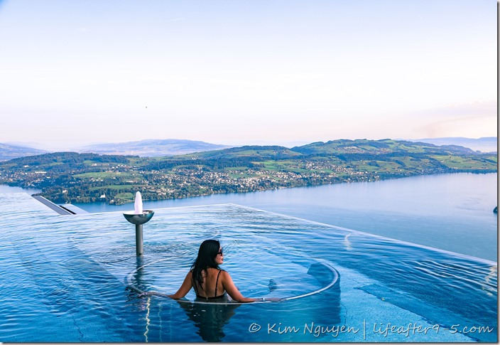 Woman admiring view from outdoor pool at Bürgenstock Alpine Spa