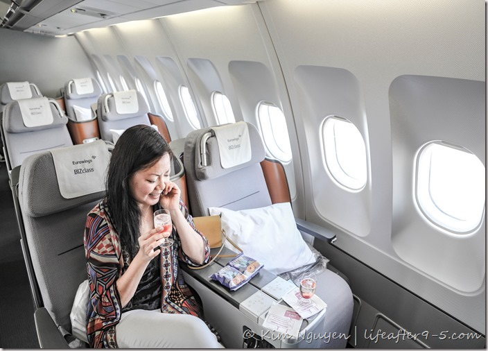 Woman sitting in Eurowings Business Class cabin